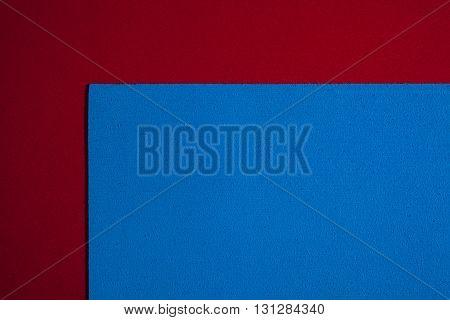 Eva foam ethylene vinyl acetate sponge plush blue surface on red smooth background