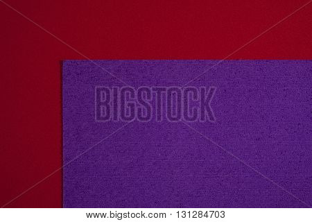 Eva foam ethylene vinyl acetate sponge plush purple surface on red smooth background