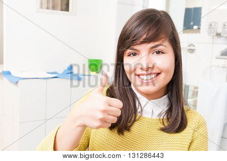 Beautiful Young Patient Thumb Up At The Dental Clinic