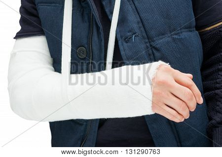 Close up hand with bandage and gypsum as body injury concept