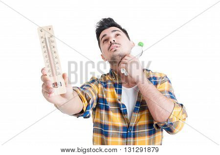 Concept Of Summer High Temperature With Man Holding Thermometer