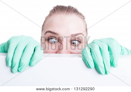 Funny Woman Doctor Holding Her Eyes Crossed  And Act Silly