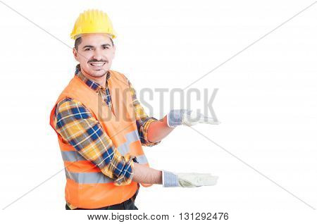 Cheerful Constructor Showing Something Small With His Hands