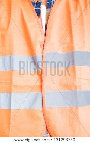 Safety Construction Concept With Orange Protection Vest In Close-up