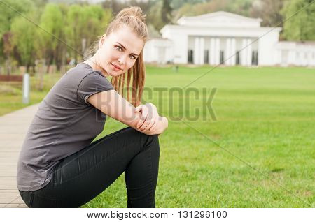 Beautiful woman enjoying freetime on summer green park and relaxing with copy space