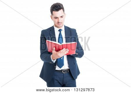 Young Attractive Lawyer Holding And Reading A Law Book