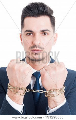 Portrait of corrupt businessman or lawyer with chained hands being arrested for breaking the law isolated on white