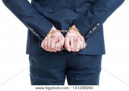 Corrupt lawyer or businessman captive in chains accused for bribe isolated on white background