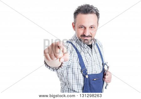 Portrait Of Attractive Repairman With Mechanical Tools Pointing At You