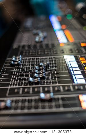 Sliders of the Hi-End stage sound controller - blurred closeup background