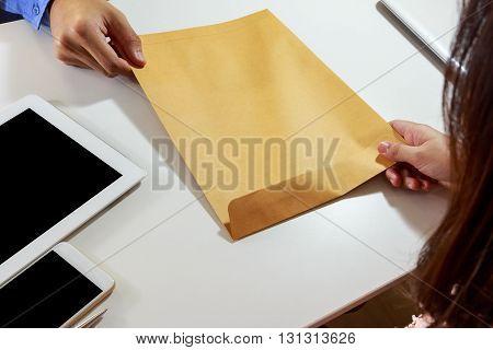Businesswoman receive letter envelope at office desk.