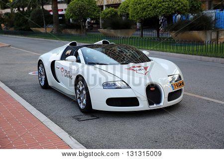 Monte-Carlo Monaco - May 17 2016: White Supercar Bugatti Veyron 16.4 Grand Sport Parked in Front of the Grimaldi Forum in Monaco