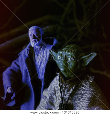 BLOOMFIELD NJ - MAY 23 2016:   Recreation of a scene from Star Wars The Empire Strikes Back with Jedi Master Yoda and Obi Wan Kenobi on Dagobah using Hasbro Action Figures.
