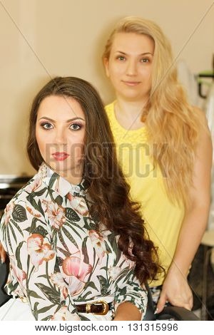 Beauty firl client and adult hairstylist posing
