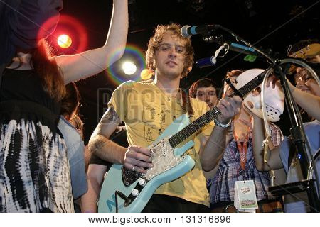 NEW YORK NY: OCT 22, 2009:  Singer John Joseph McCauley of the rock group Deer Tick with fans onstage at The Bowery Ballroom durning the CMJ Music Marathon supporting their album Born on Flag Day