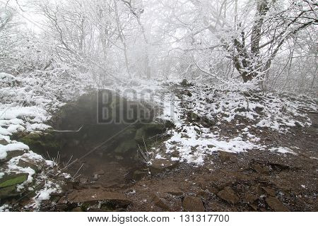 Steam rising from a fissure in the rock - Borec hill in the Czech Central Mountains - natural attraction