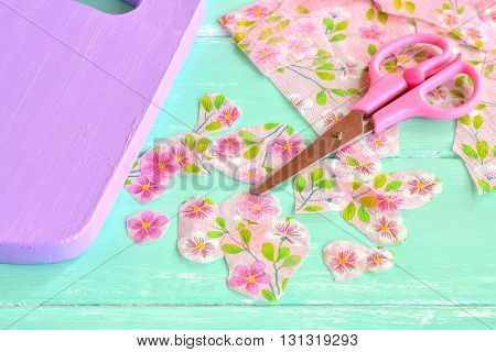Decorative painted chopping board. Cut pieces of napkins. Scissors, flowers napkin fragments. Decoupage tutorial - decorating kitchen cutting board.