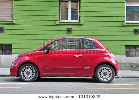 BUDAPEST HUNGARY - MAY 16: Fiat 500 parked in the street of Budapest on May 16 2016. Fiat 500 is a passenger car manufactured by Fiat since 2007.