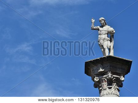 Statue of Christ the Redeemer at the top of a column in the center of Vicenza