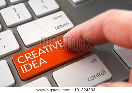 Computer User Presses Creative Idea Orange Keypad. Close Up view of Male Hand Touching Creative Idea Computer Keypad. Metallic Keyboard with Creative Idea Orange Button. 3D Illustration.