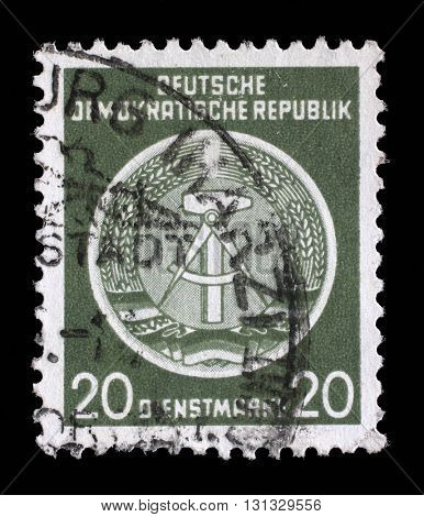 ZAGREB, CROATIA - SEPTEMBER 18: A Stamp printed in GDR (German Democratic Republic - East Germany) shows DDR national coat of arms, circa 1952, on September 05, 2014, Zagreb, Croatia