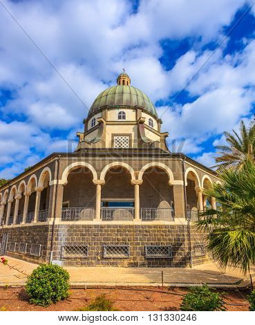 The majestic dome of the basilica is surrounded by gallery with columns. Church Sermon on the Mount - Mount of Beatitudes. Sea of Galilee, Israel