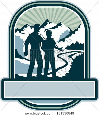 Illustration of a father and son about to start a journey together viewed from the back with mountains and sunburst in the background set inside shield crest with banner in the bottom done in retro style.