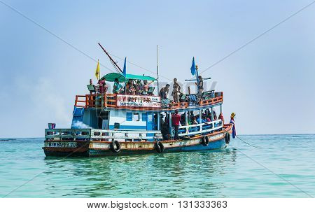 Old Wooden Ferry Boat Brings Tourists To The Small Island Of Koh Samet