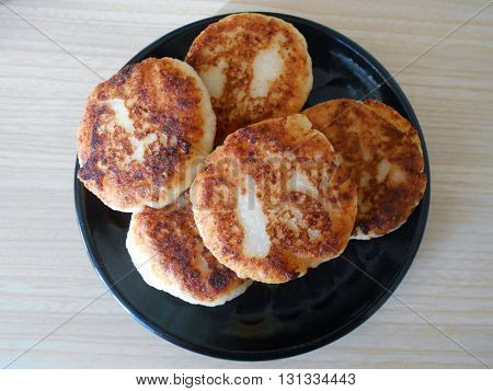 cottage cheese fritters  — a dish of Belarusian cuisine. cottage cheese fritters  are fried cottage cheese , mixed with flour and eggs.