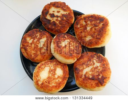 cottage cheese fritters  — a dish of Belarusian cuisine. cottage cheese fritters  are fried cottage cheese , mixed with flour and eggs.are served with sour cream.
