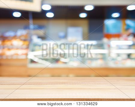 Wooden Empty Table In Front Of Blurred Bakery Shop