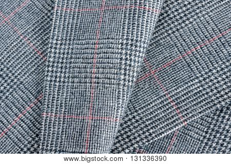 Glen plaid or Glenurquhart check a woollen fabric with a woven twill design of small and large checks used in suits and jackets