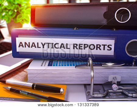Analytical Reports - Blue Office Folder on Background of Working Table with Stationery and Laptop. Analytical Reports Business Concept on Blurred Background. Analytical Reports Toned Image. 3D Render.