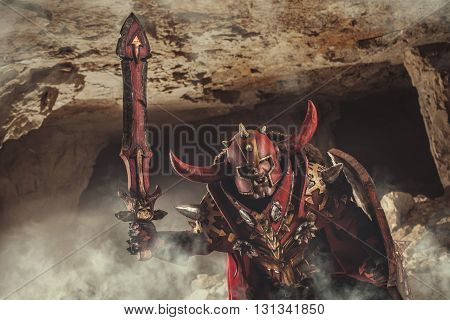Attack Of Powerful Knight In Heavy Armor On The Dungeon Background.