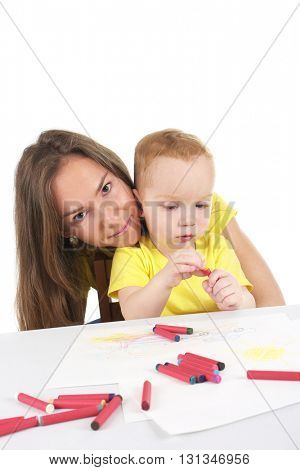 Mother and son are drawing the picture together