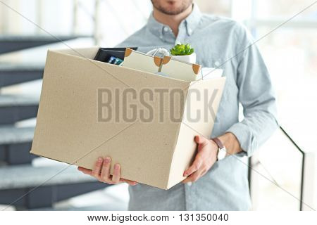 Businessman with moving box in office