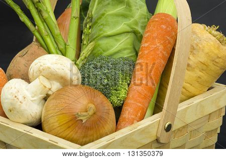 Trug of Fresh Vegetables A wooden trug of freshly harvested vegetables, promoting healthy eating and living.