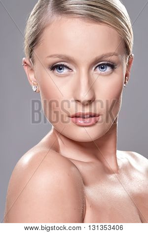 Portrait Of Beautiful Blond Model With Blue Eyes, On Grey Background