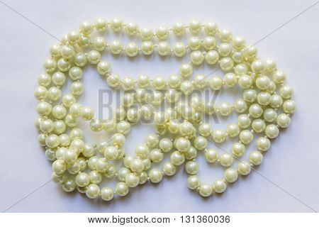 White Pearl Necklace closeup on white background