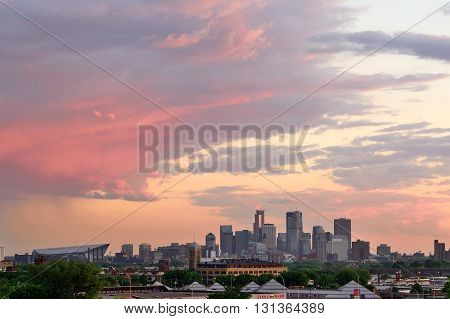 MINNEAPOLIS MN - MAY 24 2016: Downtown Minneapolis Skyline with Minnesota Vikings US Bank Stadium at Sunset