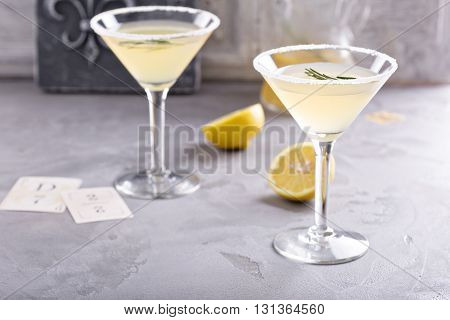 Lemonade martini with rosemary on gray background
