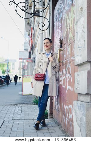 biz lady after working concept elegant woman in a beige coat