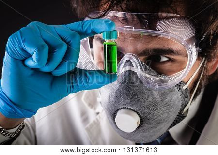Researcher Examining Vial