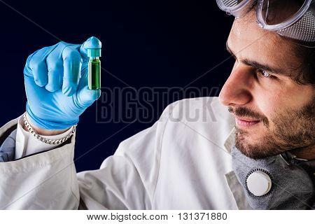 Gazing At A Green Vial