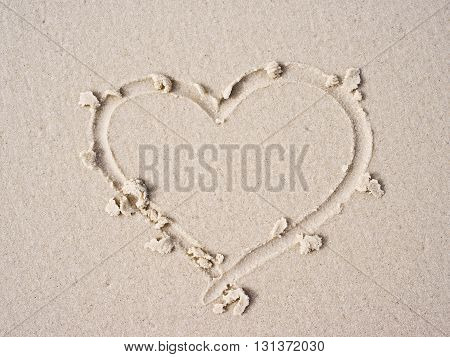 Heart drawn on sand for background. (Top view)