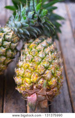 fresh pineapple on wood background, fresh fruit