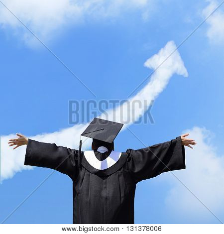 back view of happy graduate student girl hug future and feel carefree look up with cloud arrow in the sky she wear graduation cap and gown asian
