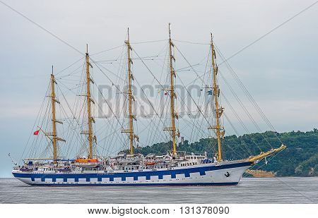 Varna Bulgaria 22th May 2016. Five-masted Royal Clippers sailing ship owned by Star Clippers - maneuvers for mooring at the passenger terminal docks of the harbor.
