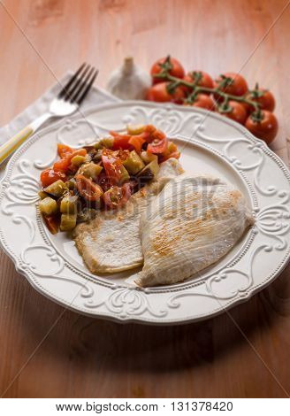 escalope with eggplants and tomatoes, selective focus