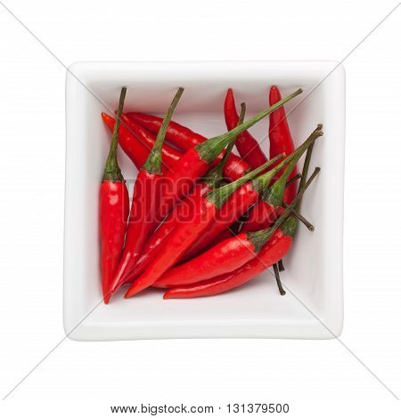 Thai chilies in a square bowl isolated on white background
